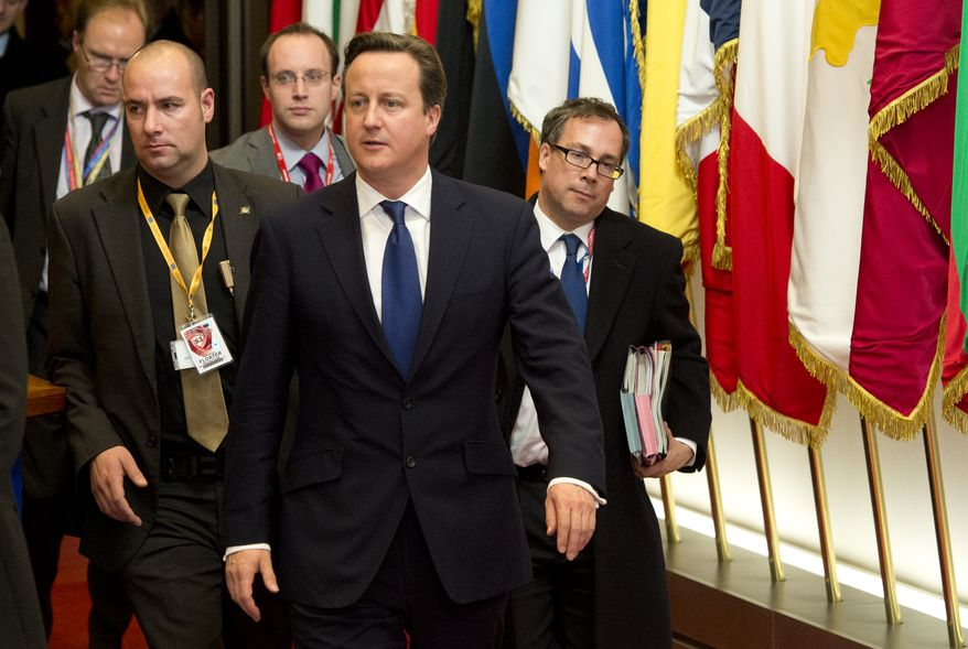 British Prime Minister David Cameron (center) departs after an EU summit in Brussels on Nov. 23, 2012. The leaders of Britain and France staked out starkly different visions of Europe's future as talks in Brussels on how much the European Union should be allowed to spend, set the stage for a long, divisive and possibly inconclusive summit. (Associated Press)