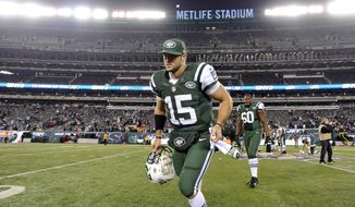 ** FILE ** New York Jets quarterback Tim Tebow leaves the field at the end of the Jets' 49-19 home loss to the New England Patriots on Nov. 22, 2012. (Associated Press)