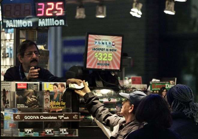 A vendor (left) receives money for a lottery purchase on Nov. 23, 2012, in New York. The jackpot for Powerball's weekend drawing has climbed to $325 million