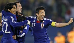 **FILE** From left: Japan's Yuji Nakazawa, Marcus Tulio Tanaka, Yasuyuki Konno and Makoto Hasebe celebrate June 24, 2010, following the World Cup group E soccer match between Denmark and Japan at Royal Bafokeng Stadium in Rustenburg, South Africa. (Associated Press)