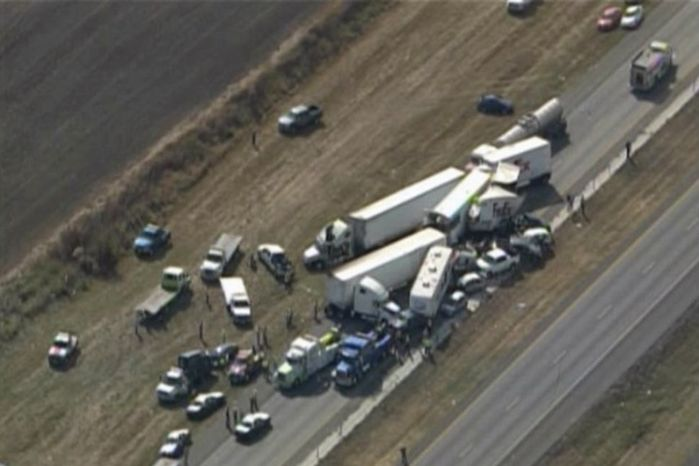 In this image provided by Click2houston.com, cars and trucks are piled on Interstate 10 in Southeast Texas on Nov. 22, 2012. The Texas Department of Public Safety said at least 35 people have been injured in the pileup. (Associated Press/Click2houston.com)