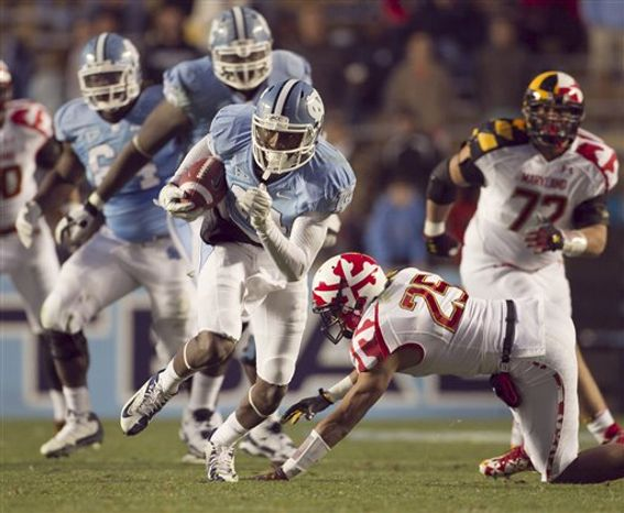 North Carolina's Quinshad Davis slips past Maryland's Dexter McDougle (25) after a pass completion from quarterback Bryn Renner for a touchdown during the third quarter of an NCAA college football game Saturday, Nov. 24, 2012, in Chapel Hill, N.C. North Carolina won 45-38. (AP Photo/The News & Observer, Robert Willett)