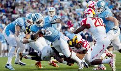 Maryland was game, but North Carolina, shown getting a second-quarter touchdown from A.J. Blue, proved too much as the Terrapins lost their season finale.  (Associated Press)