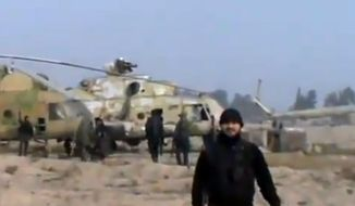 In this image taken from video that has been authenticated based on its contents and other AP reporting, Syrian rebels capture a helicopter air base near the capital, Damascus, after fierce fighting on Sunday, Nov. 25, 2012.  (AP Photo/Ugarit News via AP video)