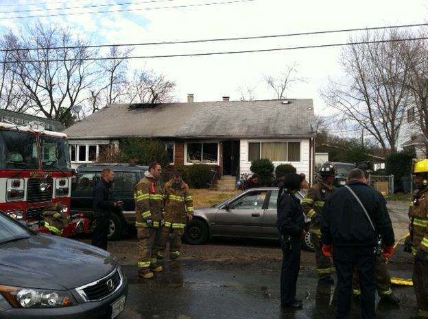 Prince George's County firefighters clean up after a Sunday morning duplex fire in Chillum that left