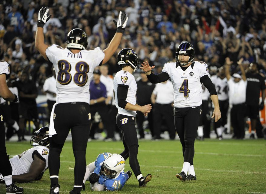 Baltimore Ravens kicker Justin Tucker (9) is congratulated by punter Sam Koch (4), as tight end Dennis Pitta (88) celebrates after Tucker kicked the game-winning field goal inovertime during an NFL football game against the San Diego Chargers, Sunday, Nov. 25, 2012, in San Diego. The Ravens won 16-13. (AP Photo/Denis Poroy)