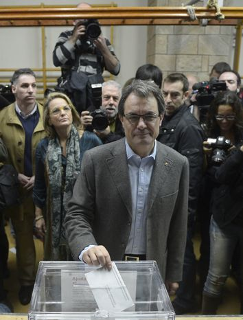 Artur Mas, leader of the center-right Catalan Nationalist Coalition (CiU) party, casts his vote in Barcelona during Catalan regional elections on Sunday,