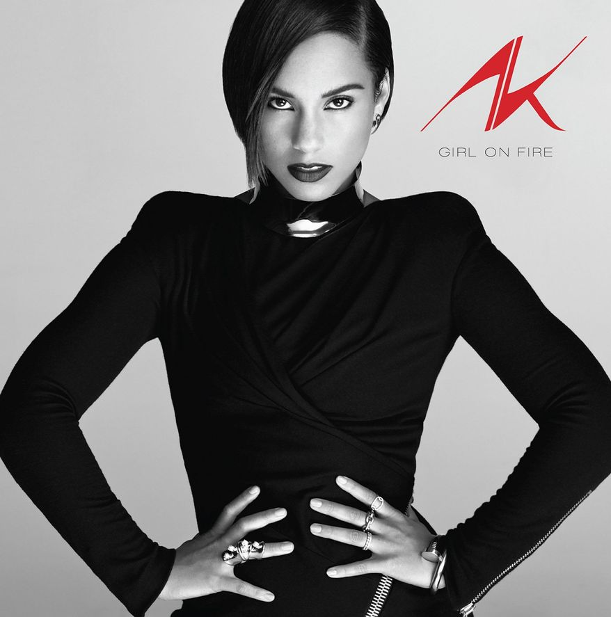 "This album cover image provided by RCA Records shows the latest release by Alicia Keys, ""Girl on Fire."" It's her first release after her marriage to producer-rapper Swizz Beatz and the birth of their son Egypt. (AP Photo/RCA Records)"