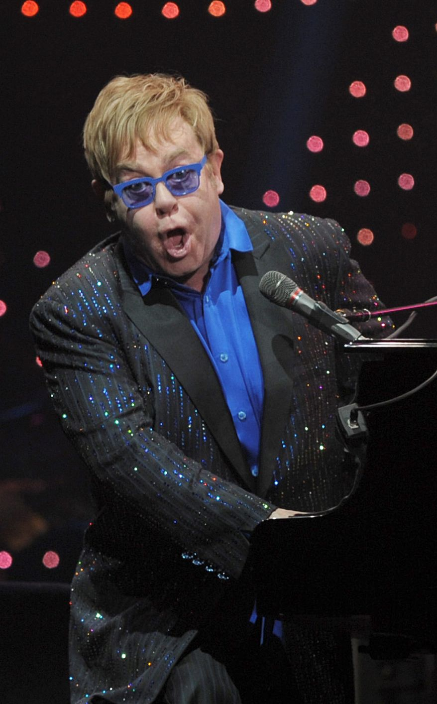 Elton John performs Sunday in Beijing, where he shocked the audience by announcing that he was dedicating the show to Chinese dissident Ai Weiwei. (Associated Press)