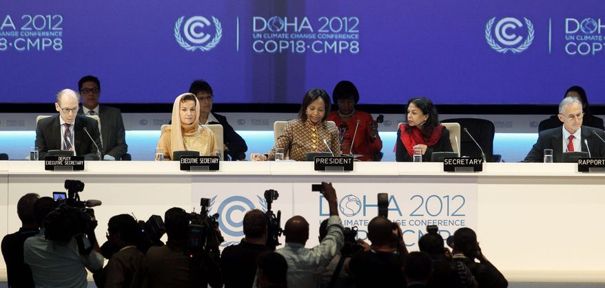 Organizers gather at the opening of the 18th United Nations climate change conference in Doha, Qatar, on Monday. (Associated Press)