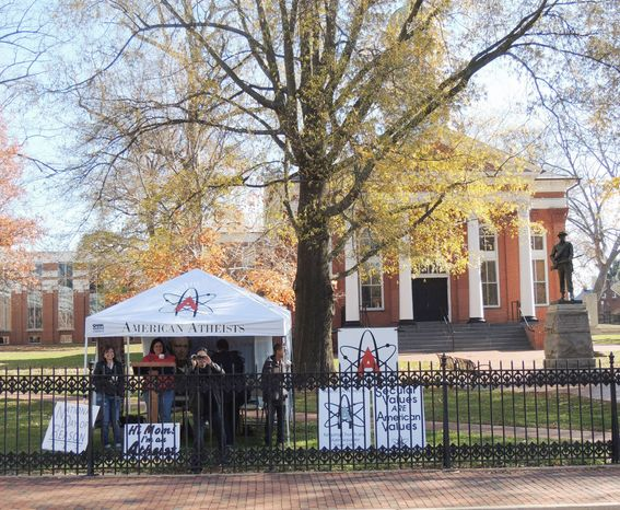 ** FILE ** In this Nov. 26, 2012, file photo, American Atheists members have set up their tent previously at the Loudoun County, Va., courthouse. The group planned to return to the site Dec. 8 and other days during the Christmas season to promote separation of church and state. (Courtesy of Rick Wingrove)