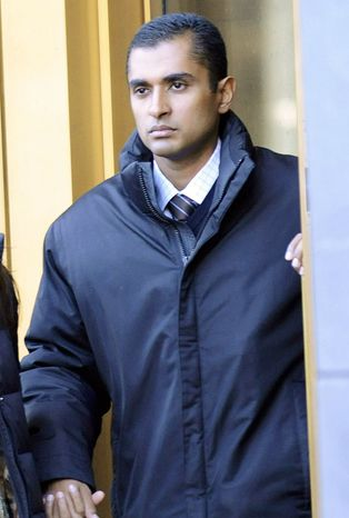 Mathew Martoma, former SAC Capital Advisors hedge fund portfolio manager, exits court in New York on Monday. Mr. Martoma was released on $5 million bail after his 12-minute appearance before a federal magistrate judge. His movements were restricted. (Associated Press)