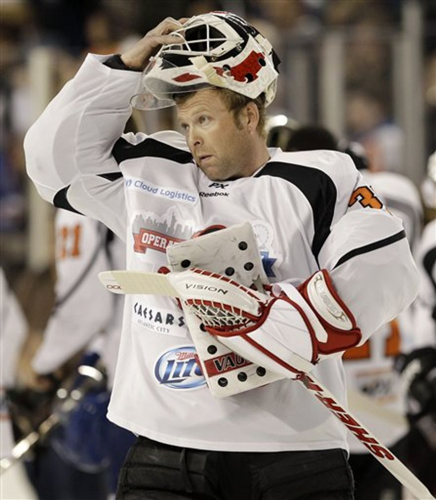 """Martin Brodeur called Roman Hamrlik's comments criticizing Donald Fehr and the NHLPA's course during the NHL lockout a """"sign of weakness."""" (Associated Press)"""