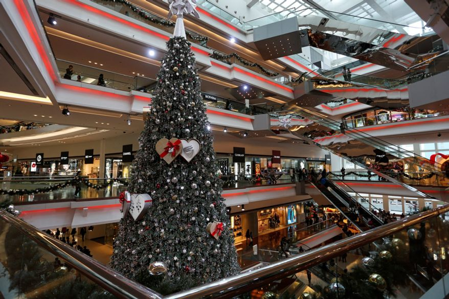 A Christmas tree is displayed at a shopping mall in Hong Kong as the city prepares to celebrate the Christmas holidays on Monday, Nov. 26, 2012. (AP Photo/Vincent Yu)