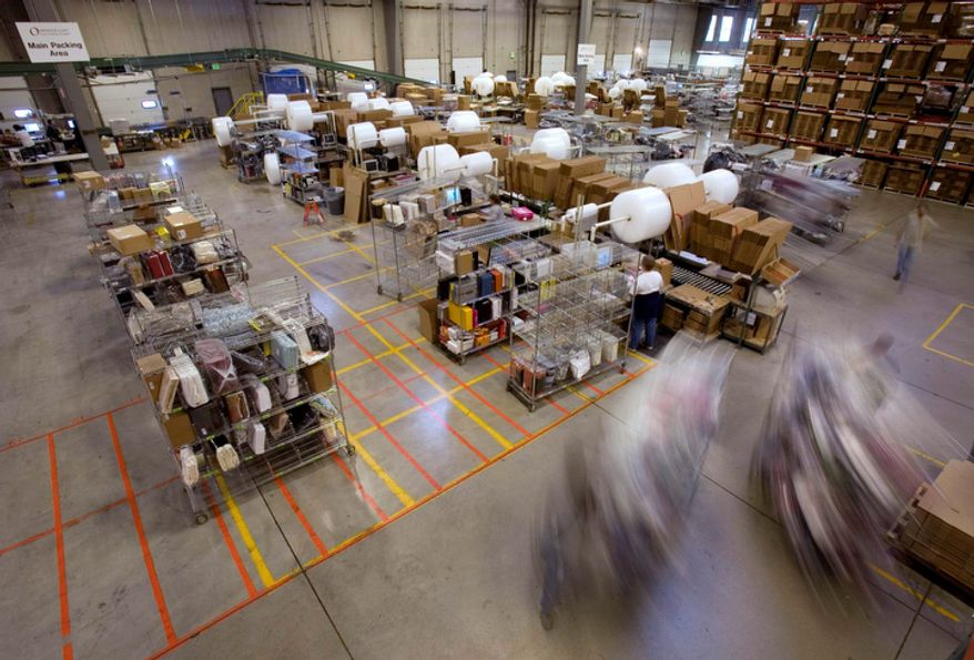 "Carts full of merchandise ordered online are rolled to the main packing area for shipping at the Overstock.com warehouse in Salt Lake City on Friday, Nov. 29, 2008. ""Cyber Monday,"" coined in 2005 by a shopping trade group that noticed a spike in online sales on the Monday after Thanksgiving when people returned to their work computers, is the next in a line of days that stores are counting on to jump-start the holiday shopping season. This year it is expected to be the biggest online shopping day of the year for the third year in a row. (AP Photo/Douglas C. Pizac)"