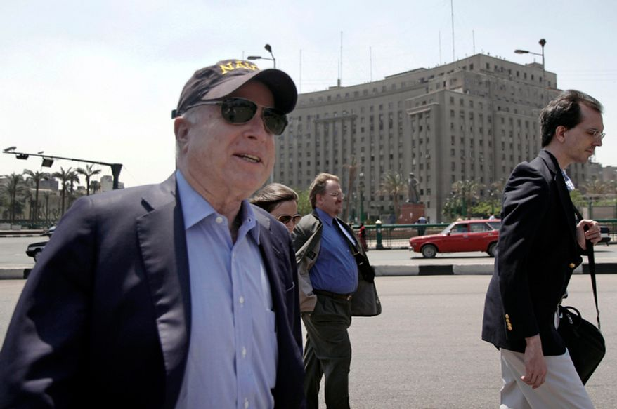 Sen. John McCain walks through Tahrir Square in Cairo after meeting with the U.S. ambassador to Egypt on Sunday, April 24, 2011. (AP Photo/Matt Ford)