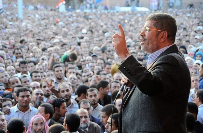 """Egyptian President Mohammed Morsi speaks to supporters outside the Presidential Palace in Cairo on Friday, Nov. 23, 2012. MENA, Egypt's official news agency, says the country's highest body of judges has called the president's recent decrees an """"unprecedented assault on the independence of the judiciary and its rulings."""" In a statement ca"""