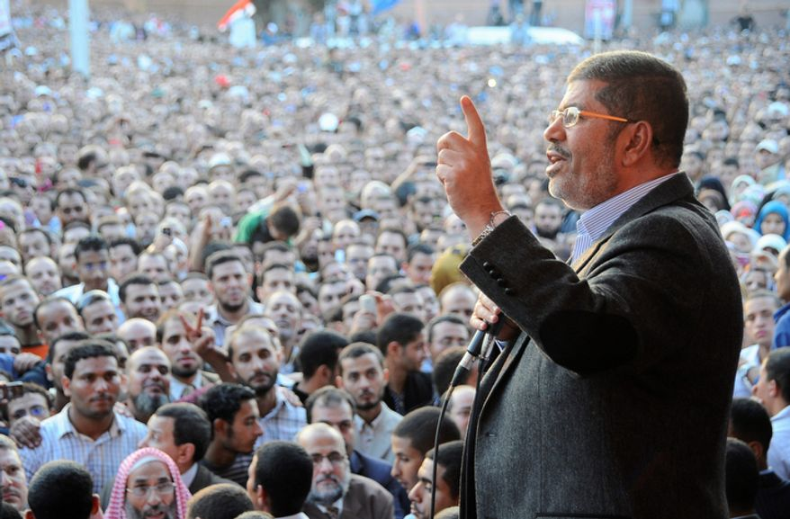 "Egyptian President Mohammed Morsi speaks to supporters outside the Presidential Palace in Cairo on Friday, Nov. 23, 2012. MENA, Egypt's official news agency, says the country's highest body of judges has called the president's recent decrees an ""unprecedented assault on the independence of the judiciary and its rulings."" In a statement carried by MENA on Saturday, the Supreme Judicial Council said it regrets the declarations Mr. Morsi issued Thursday. (AP Photo/Egyptian Presidency)"