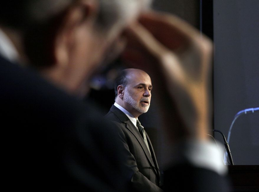 """** FILE ** Federal Reserve Chairman Ben S. Bernanke addresses a luncheon gathering of the Economic Club of New York on Tuesday, Nov. 20, 2012. Mr. Bernanke urged Congress and the Obama administration to strike a budget deal to avert tax increases and spending cuts that could trigger a recession next year. Without a deal, the measures known as the """"fiscal cliff"""" will take effect in January. (AP Photo/Richard Drew)"""