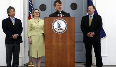 Virginia Gov. Robert F. McDonnell (at podium) addresses President Obama's announcement of offshore oil and gas exploration as (from left) Virginia Secretary of Commerce and Trade Jim Cheng, Deputy Secretary of Natural Resources Maureen Matsen and Secretary of Natural Resources Dout Domenech look on at the Capitol in Richmond on Wednesday, March 31, 2010. (AP Photo/Richmond Times-Dispatch, Bob Brown)