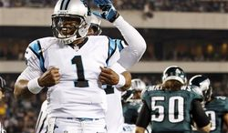 Carolina Panthers quarterback Cam Newton (1) reacts after scoring a touchdown in the second half of an NFL game against the Philadelphia Eagles, Monday, Nov. 26, 2012, in Philadelphia. (AP Photo/Mel Evans)