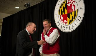 University of Maryland football head coach Randy Edsall (right) chats with Big Ten Commissioner James E. Delany (left) following a press conference to announce the University of Maryland's joining the Big Ten Conference at the University of Maryland in College Park on Monday, Nov. 19, 2012. (Rod Lamkey Jr./The Washington Times)