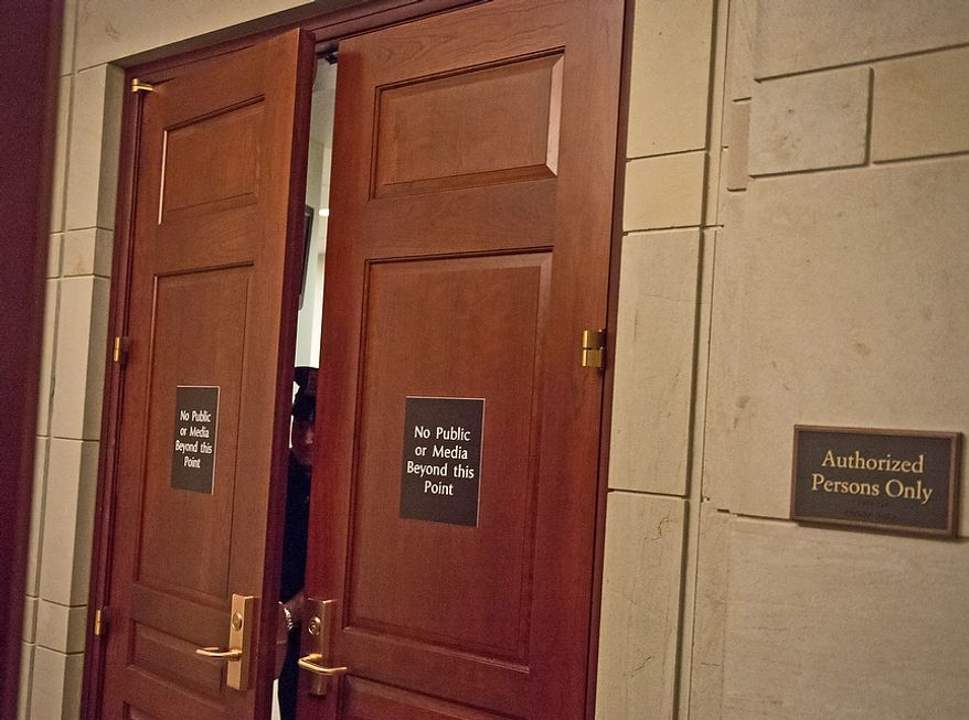A Capitol Hill Police officer stands guard as former CIA Director David H. Petraeus allegedly meets with lawmakers behind closed doors inside the Capitol Visitors Center on Capitol Hill on Washington on Friday, Nov. 16, 2012. (Andrew Harnik/The Washington Times)