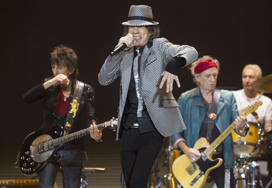 Mick Jagger (second from left), Keith Richards (second from right), Ronnie Wood (left) and Charlie Watts of the Rolling Stones perform at the O2 Arena in east London on Sunday, Nov. 25, 2012, in celebration of the band's 50th anniversary. (Joel Ryan/Invision/AP)