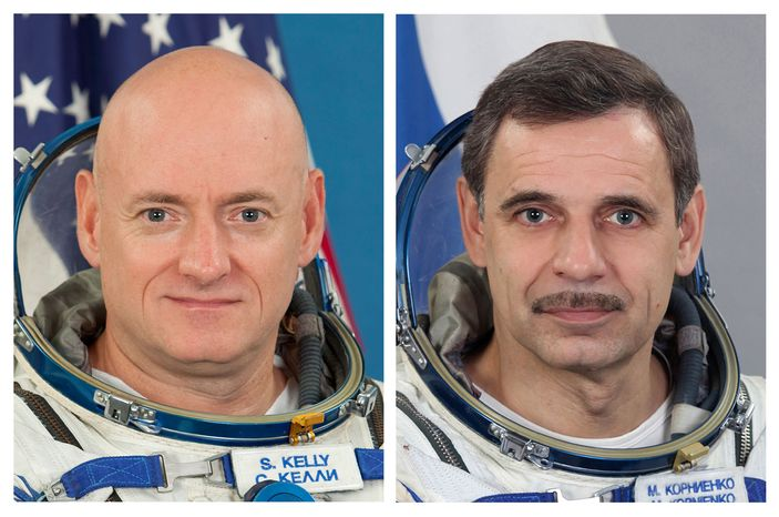 U.S. astronaut Scott Kelly (left) and Russian cosmonaut Mikhail Kornienko will spend an entire year aboard the International Space Station beginning in 2015. The extended mission will provide a medical foundation for future missions around the moon, as well as far-flung trips to asteroids and Mars. (AP Photo/Gagarin Cosmo