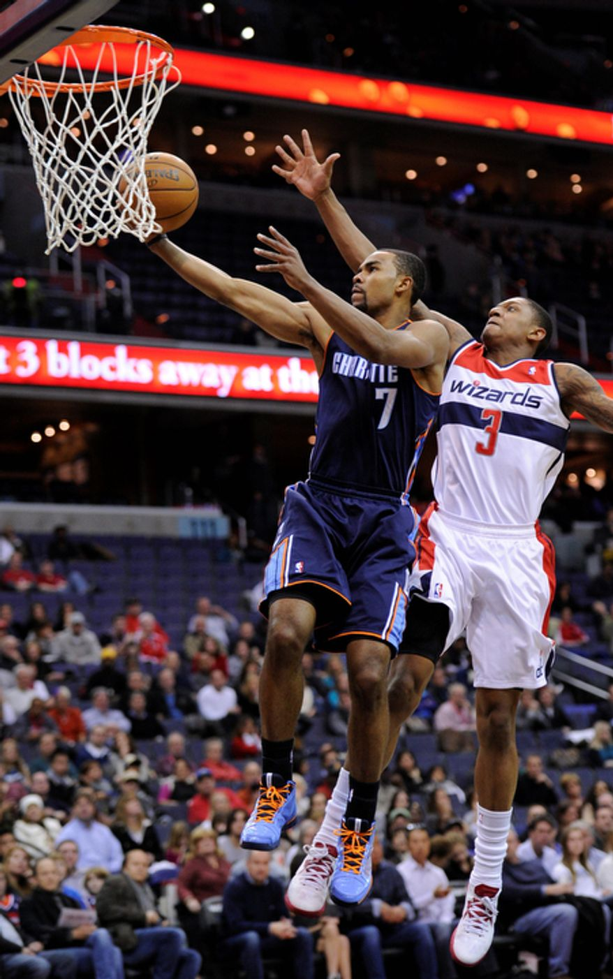 Charlotte Bobcats guard Ramon Sessions (7) goes to the basket against Washington Wizards guard Bradley Beal (3) during the first half of an NBA basketball game on Saturday, Nov. 24, 2012, in Washington. (AP Photo/Nick Wass)