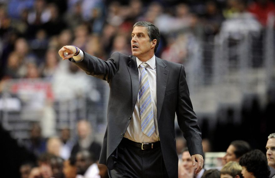 Washington Wizards head coach Randy Wittman points during the second half of an NBA basketball game against the Charlotte Bobcats, Saturday, Nov. 24, 2012, in Washington. Charlotte won 108-106 in double overtime. (AP Photo/Nick Wass)