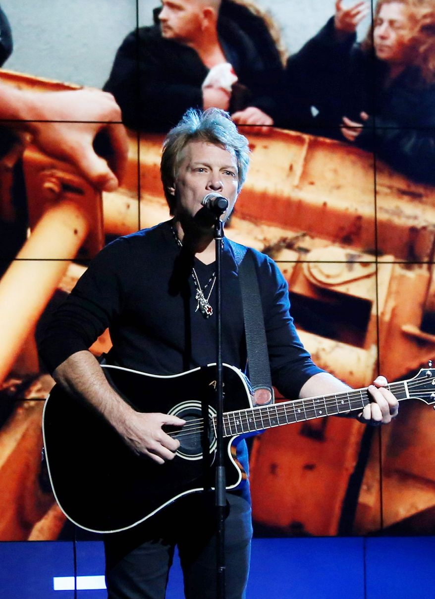 Jon Bon Jovi will perform at the Superstorm Sandy benefit concert at Madison Square Garden on Dec. 12. Dave Grohl, Eddie Vedder, Bruce Springsteen & The E Street Band, and Paul McCartney also will perform. (Associated Press)