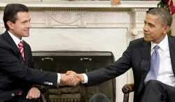 ** FILE ** In this Nov. 27, 2012, file photo, President Obama meets with Mexican President-elect Enrique Pena Nieto in the White House, setting the stage for boosting relations between the nations. (Associated Press)