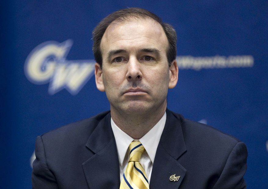 Mike Lonergan pauses during a news conference to announce him as the new head coach for men's basketball at George Washington University on Monday, May 9, 2011, in Washington.  (AP Photo/Evan Vucci)