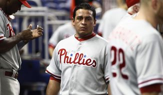 Philadelphia Phillies' Carlos Ruiz stands in the dugout during the first inning of a MLB baseball game in Miami, Sunday, Sept. 30, 2012. (AP Photo/J Pat Carter)