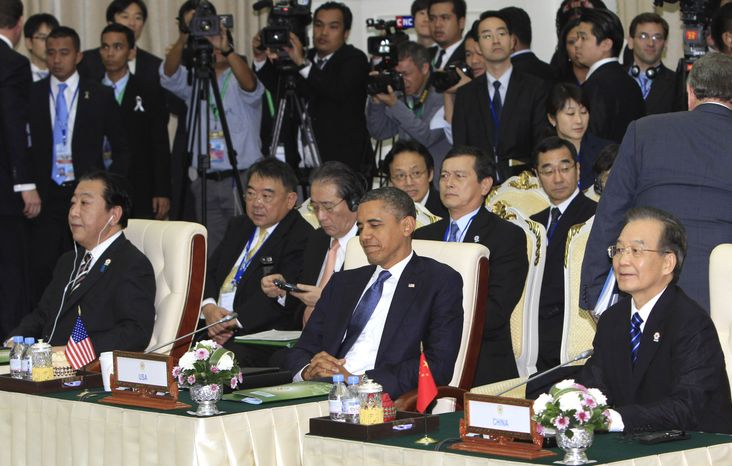 Japan's Prime Minister Yoshihino Noda, front left, U.S. President Barack Obama, center front, and Chinese Premier Wen Jiabao, sitting right, attend the East Asia Summit at the Peace Palace in Phnom Penh, Cambodia Tuesday, Nov. 20, 2012. (AP Photo/Heng Sinith)
