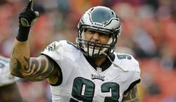 Philadelphia Eagles defensive end Jason Babin reacts to a play during the second half of an NFL football game against the Washington Redskins in Landover, Md., Sunday, Nov. 18, 2012. (AP Photo/Alex Brandon)