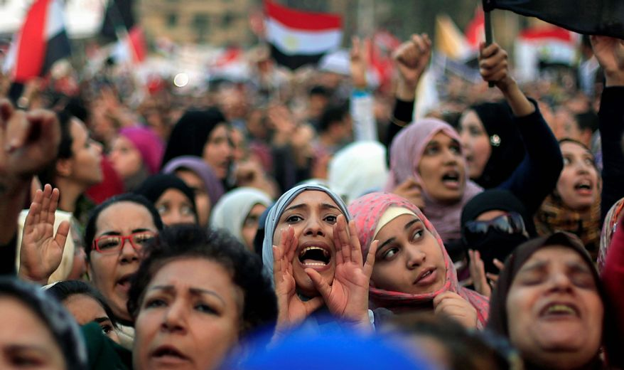 Egyptian protesters chant slogans against President Mohammed Morsi in Tahrir Square in Cairo on Tuesday, Nov. 27, 2012. Demonstrators flocked to the central square for a protest against Mr. Morsi in a significant test of whether the opposition can rally the street behind it in a confrontation aimed at forcing the Islamist leader to rescind decrees that granted him near absolute powers. (AP Photo/Khalil Hamra)