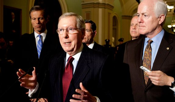 Senate Minority Leader Mitch McConnell (center) gestures during a news conference on Capitol Hill in Washington on Wednesday, Nov. 14, 2012. With him (from left) are Sens. John Thune, John Barrasso, Jerry Moran and John Cornyn. (AP Photo/Harry Hamburg)