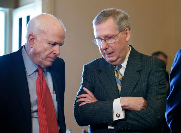 Senate Minority Leader Mitch McConnell (right), Kentucky Republican, confers with Sen. John McCain, Arizona Republican, as they wait with other senators for the arrival of Israeli Prime Minister Benjamin Netanyahu at the Capitol in Washington on Tuesday, March 6, 2012. (AP Photo/J. Scott Applewhite)