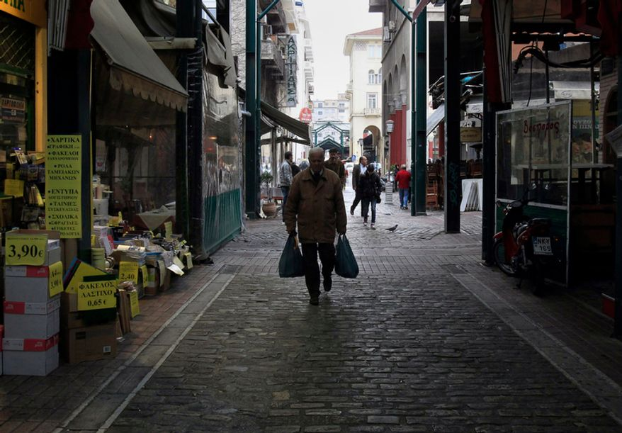 A man walks in the main market, in the northern port of city Thessaloniki, Greece, Wednesday, Nov. 21, 2012. Greece reacted with dismay Wednesday after European finance ministers failed to agree to release vital rescue loans, with the prime minister warning that the stakes are higher than just his debt-ridden country's future. (AP Photo/Nikolas Giakoumidis)