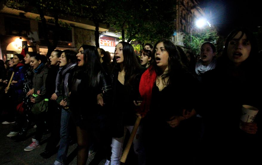 Protesters chant slogans during a protest commemorating the student uprising against a military dictatorship in 1973, at the northern city of Thessaloniki  Greece, Saturday, Nov. 17, 2012. (AP Photo/Nikolas Giakoumidis)