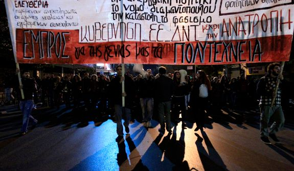 "Protesters march during a protest commemorating the student uprising against a military dictatorship in 1973, at the northern city of Thessaloniki, Greece, Saturday, Nov. 17 2012. The banner is reading ""Against Government - IMF - EU. (AP Photo/Nikolas Giakoumidis)"