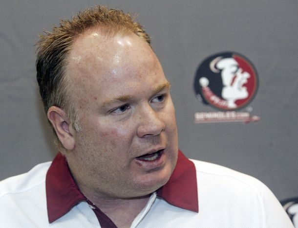 FILE - In this Aug. 12, 2012, file photo, Florida State defensive coordinator Mark Stoops is interviewed during the Seminoles' football media day in Tallahassee, Fla. Kentucky has hired Florida State defensive coordinator Mark Stoops as its new football coach. The
