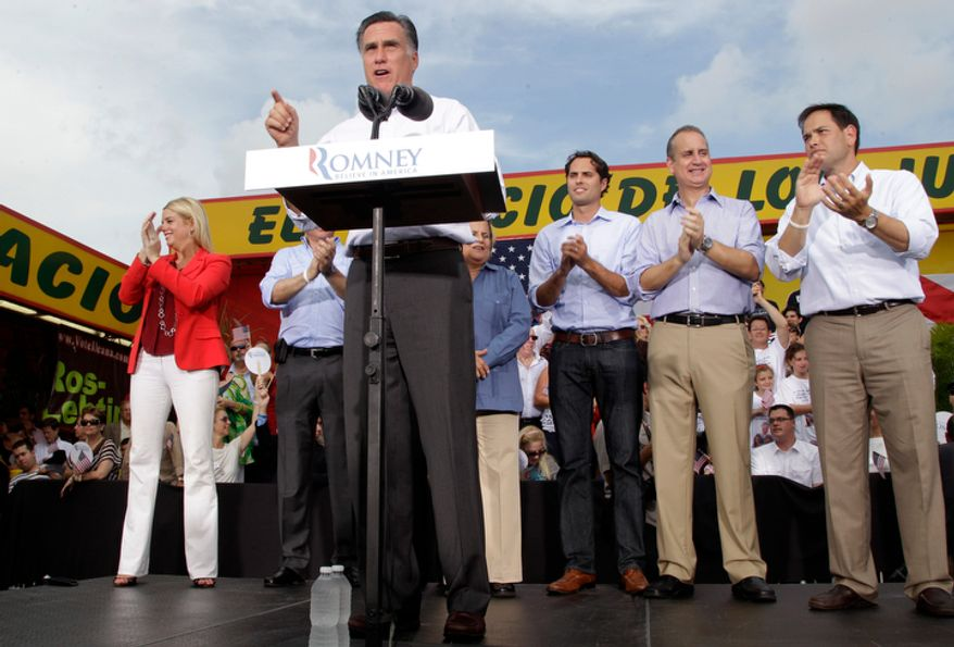 Republican presidential candidate Mitt Romney speaks during a campaign event at El Palacio de los Jugos in Miami on Monday, Aug. 13, 2012. Puerto Ricans and Cubans are the largest Latin American communities in Florida, and their votes could decide the state in the 2012 presidential election. (AP Photo/Mary Altaffer)