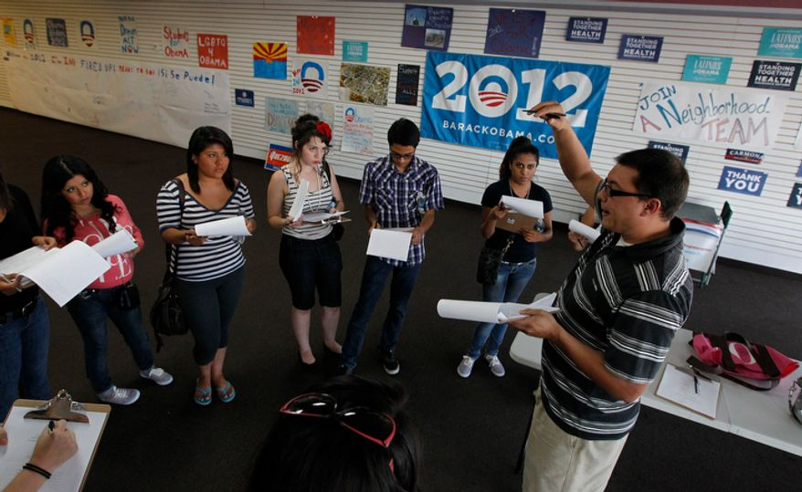 Brian Conklin (far right), a regional campaign director for President Obama, briefs volunteers about registering new voters prior before they canvass a heavily Latino neighborhood on Friday, June 29, 2012, in Phoenix.  Across the country, both political parties have been courting the Latino vote, the nation's fastest-growing minority group. (AP Photo/Ross D. Franklin)