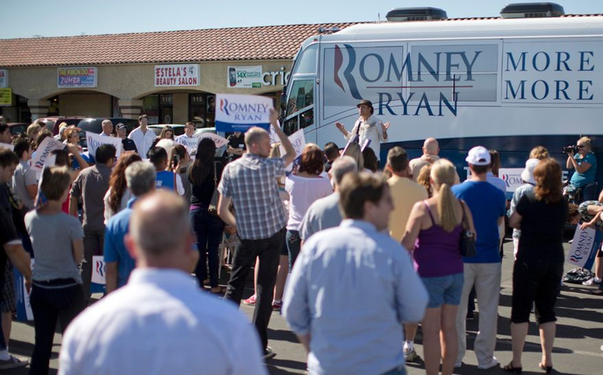 Comedian Paul Rodriguez speaks to a crowd of Mitt Romney supporters outside a Romney campaign office in Las Vegas on Saturday, Oct. 20, 2012. Romney officials argue that Hispanics, who suffer from a 9.9 percent unemployment rate, more than 2 points higher than the national rate, are naturally drawn to the GOP ticket. But some Romney supporters are pessimistic that Republicans can make inroads with a population that, many polls show, favors President Obama by a 2-1 margin. (AP Photo/Julie Jacobson)