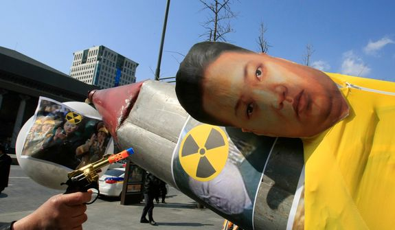 A South Korean protester aims a toy gun at an effigy of North Korean leader Kim Jong-un that is set on a mock North Korean missile during an anti-North Korea rally denouncing the North's plan to launch a long-range rocket, in Seoul on Tuesday, March 20, 2012. North Korea vowed Sunday to go ahead with plans to launch the rocket, rejecting criticism in the West that it would scuttle recent diplomacy. (AP Photo/Lee Jin-man)