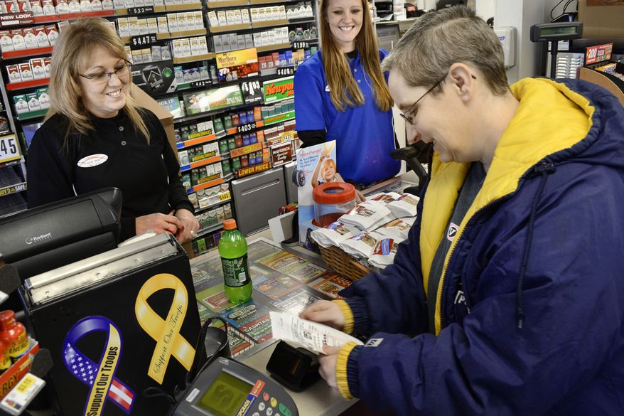 Store manager Julie Rebennack (left) and customer service representative Megan Horn (center) wish Lori Soule (right), 48, good luck after Ms. Soule purchased a Powerball ticket on Monday, Nov. 26, 2012, at a Speedway convenience store in Marion, Ind. Wednesday's Powerball jackpot will be a predicted $425 million, the game's largest jackpot ever. (AP Photo/The Chronicle-Tribune, Jeff Morehead)