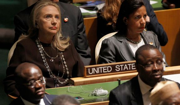 U.S. Secretary of State Hillary Rodham Clinton (left) and Susan Rice, U.S. ambassador to United Nations, listen as President Obama addresses the 67th session of the U.N. General Assembly at the world body's headquarters on Tuesday, Sept. 25, 2012. (AP Photo/Mary Altaffer)